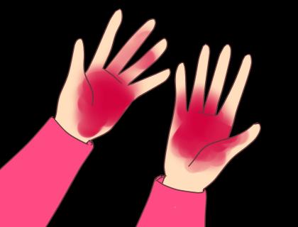 赤く染まる手